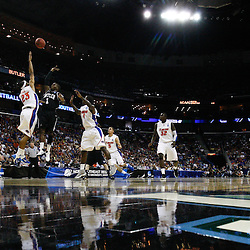 Mar 26, 2011; New Orleans, LA; Butler Bulldogs guard Shelvin Mack (1) shoots over Florida Gators forward Alex Tyus (23) during the first half of the semifinals of the southeast regional of the 2011 NCAA men's basketball tournament at New Orleans Arena.   Mandatory Credit: Derick E. Hingle