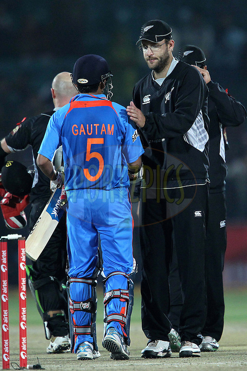 Daniel Vettori congratulates Gautam Gambhir (capt.) on the win for India during the 2nd ODI ( One Day International ) between India and New Zealand held at the Sawai  Mansingh Cricket Stadium in Jaipur, Rajasthan India on the 1st December 2010..Photo by Ron Gaunt/BCCI/SPORTZPICS
