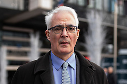 © Licensed to London News Pictures. 10/12/2018. London, UK. Labour MP Alistair Darling leaves the Park Plaza Hotel in London, where politicians were attending the 'Conservative Friends Of Israel' annual lunch. Photo credit : Tom Nicholson/LNP
