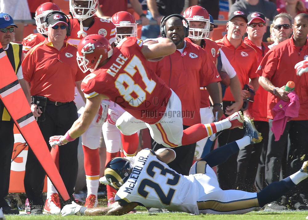 Oct 26, 2014; Kansas City, MO, USA; Kansas City Chiefs tight end Travis Kelce (87) catches a pass and is tackled by St. Louis Rams free safety Rodney McLeod (23) during the second half at Arrowhead Stadium. The Chiefs won 34-7. Mandatory Credit: Denny Medley-USA TODAY Sports