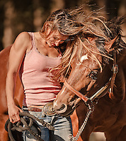 Fit young woman interacting with her horse on a windy day. Petaluma, California, USA.<br />