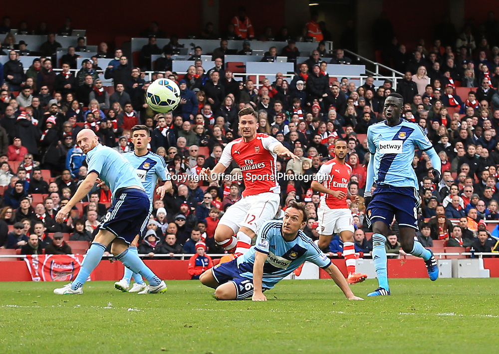 14 March 2015 - Barclays Premier League - Arsenal v West Ham - Olivier Giroud of Arsenal scores the opening goal - Photo: Marc Atkins / Offside.
