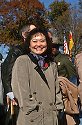 Phan Thi Kim Phuc, a napalm victim pictured in a Pulitzer Prize-winning 1972 photo by Nick Ut during a Veterans Day ceremony at the Vietnam Veterans Memorial November 11, 1996 in Washington, DC.