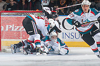 KELOWNA, CANADA - FEBRUARY 10: Ty Ronning #7 of the Vancouver Giants is checked by Gordie Ballhorn #4 and falls into the net of Brodan Salmond #31 of the Kelowna Rocketson February 10, 2017 at Prospera Place in Kelowna, British Columbia, Canada.  (Photo by Marissa Baecker/Shoot the Breeze)  *** Local Caption ***