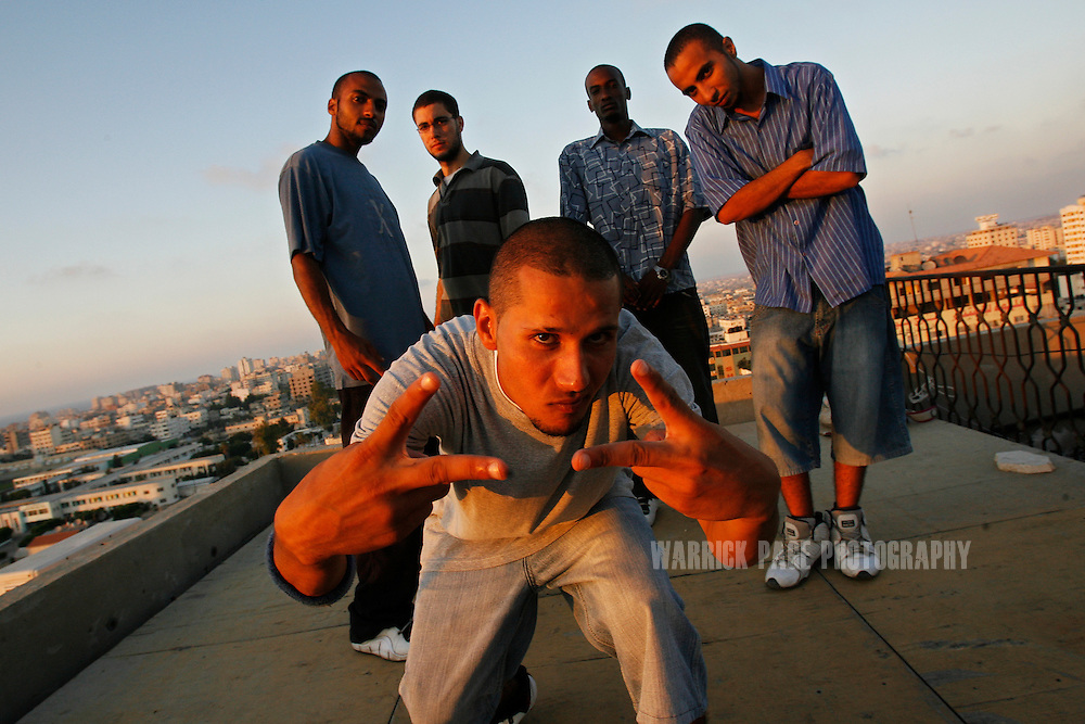 "GAZA CITY, GAZA STRIP - AUGUST 21: Members of Palestinian hip-hop group ""DARG"" (L-R), Bassam Elmasry, Ma'aroof, Mohammed Antar, Sami Srour and Madhi Elmasry stand for a portrait on a rooftop overlooking Gaza on August 21, 2009, in Gaza City, Gaza Strip. Hip-hop has grown with popularity throughout Gaza for almost a decade, but as Hamas grows more conservative in an effort to appease a growing number of hardline Islamists, artists such as ""Palestinian Unit"" and ""Darg"" are finding it more and more challenging to  propagate their message on war, poverty and civil strife to the youth of Gaza. Their lyrics and behavior on stage is scrutinized by Hamas officials and no performance can be made without prior approval. Many of them have faced repeated harassment due to their western-style  music and appearance. (Photo by Warrick Page)"