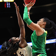 March 31, 2019; Portland, OR, USA;  Mississippi State Bulldogs forward Anriel Howard (5) defends Oregon Ducks forward Satou Sabally (0) in the Elite Eight of the NCAA Women's Tournament at Moda Center.<br /> Photo by Jaime Valdez