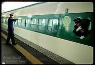 Stationmaster gives 'all aboard' signal to engineer of bullet train (Shinkansen) @ Utsunomiya. Japan