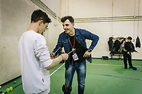 """NAPLES, ITALY - 16 MARCH 2018: Michelangelo Ravone (23, right) teaches diabolo to a teenager at """"Il Tappeto di Iqbal"""" (Iqbal's carpet), a non-profit cooperative in Barra, the estern district of Naples, Italy, on March 16th 2018.<br /> <br /> Il Tappeto di Iqbal (Iqbal's Carpet) is a non-profit cooperative founded in 2015 and Save The Children partner since 2015 that operates in the Naple's eastern neighborhood of Barra children in the arts of circus, theater and parkour. It was named after Iqbal Masih, a Pakistani boy who escaped from life as a child slave and became an activist against bonded labor in the 1990s.<br /> Barra, which is home to some 45,000 people, has the highest rate of school dropouts in the Italian region of Campania. Once a thriving industrial community, many of the factories were destroyed in a 1980 earthquake and never rebuilt. The resulting de-industrialization turned Barra into a poor, decaying neighborhood. There are no cinemas, theaters, parks or public spaces in Barra.<br /> The vast majority of children from poor families are faced with the choice of working in the black economy or joining the ranks of the organised crime.<br /> Recently, Save the Children Italy opened a number of educational and social spaces in Barra. The centers, known as Punti Luce, or points of light, aim to help local kids stay out of the ranks of the organised crime and have also become hubs for Iqbal's Carpet to work."""