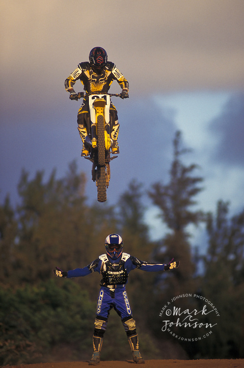 Motocross rider jumping over a friend, Kauai, Hawaii