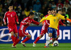 Korea's Pak Nam Chol vs Brazil's Luis Fabiano  during the 2010 FIFA World Cup South Africa Group G match between Brazil and North Korea at Ellis Park Stadium on June 15, 2010 in Johannesburg, South Africa.  (Photo by Vid Ponikvar / Sportida)