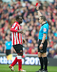 SUNDERLAND, ENGLAND - Sunday, March 20, 2011: Sunderland's John Mensah is shown the red card by referee Kevin Friend during the Premiership match against Sunderland at the Stadium of Light. (Photo by David Rawcliffe/Propaganda)