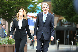 © Licensed to London News Pictures. 04/10/2017. Manchester, UK. Philip Hammond & wife in Manchester this morning ahead of Theresa May's speech on the third & final day of the Conservative Party Conference today in Manchester. Photo credit: Andrew McCaren/LNP