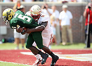 FSU's Defensive Tackle #93 Everett Dawkins pulls USF's RB Lindsey Lamar into the end zone for what appeared to be a Safety only to be ruled down on the 1 yard line.  USF defeated No. 18 FSU 17-7, Saturday, 26 Sep 09, at Doak Campbell Stadium in front of 12,000 fans. First meeting between the schools and was viewed by FSU's biggest home crowd in four years.