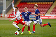 Scotland's Connor Barron (Aberdeen) receives a caution for this challenge on Nicola Zalewski during the U17 European Championships match between Scotland and Poland at Firhill Stadium, Maryhill, Scotland on 26 March 2019.