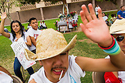 23 APRIL 2012 - PHOENIX, AZ:   High School students pray in front of a makeshift alter on the lawn after their arrival at the Arizona State Capitol in Phoenix Monday. About 200 high school students from across the Phoenix metropolitan area rallied at the Arizona state capitol in Phoenix Monday to show their opposition to Arizona's tough anti-immigration law, SB 1070. April 23 is the 2nd anniversary of the law's signing. The US Supreme Court is taking up the law during a hearing Wednesday, April 25 in Washington DC.         PHOTO BY JACK KURTZ
