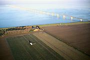 Nederland, Zeeland, Noord-Beveland, Oud-Noord-Beveland polder, 15/11/2001; Zeelandbrug over Oosterschelde (Roompot) in richting Schouwen Duiveland; besproeien gewassen, structuur vh landschap.<br /> luchtfoto (toeslag), aerial photo (additional fee)<br /> photo/foto Siebe Swart