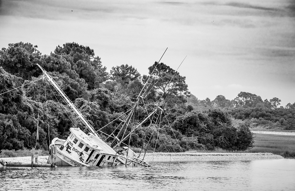 The Sum Day shrimp boat lies abandoned on the Little River near Calabash, North Carolina
