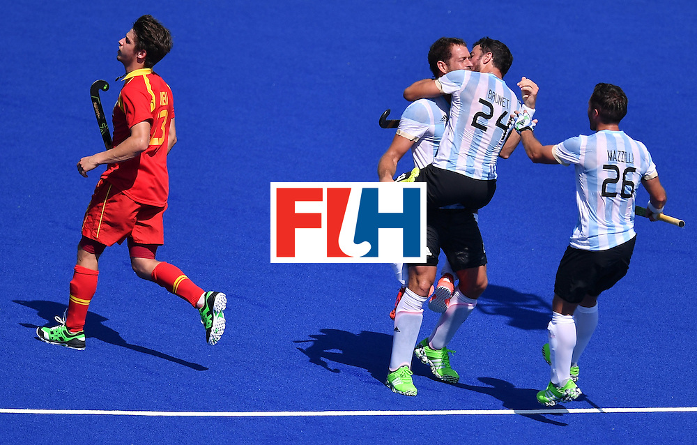Argentina's Juan Gilardi (3rd R) celebrates a goal with teammates Argentina's Agustin Mazzilli (R) and Argentina's Manuel Brunet during the men's quarterfinal field hockey Spain vs Argentina match of the Rio 2016 Olympics Games at the Olympic Hockey Centre in Rio de Janeiro on August 14, 2016. / AFP / MANAN VATSYAYANA        (Photo credit should read MANAN VATSYAYANA/AFP/Getty Images)