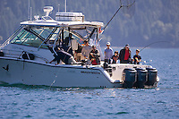 A 21 pd Spring Salmon is brought up to the boat, a prize catch for this family while fishing at Sonora Lodge.  Sonora Island, Discovery Island's, British Columbia, Canada