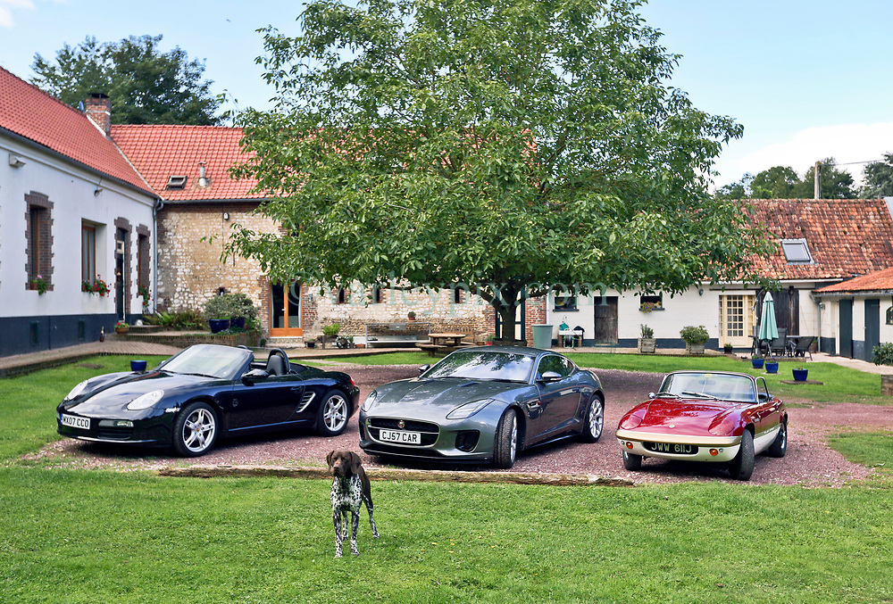 05 Sept 2019. St Denoeux, Pas de Calais, France.<br /> Messing about with cars. With Rob, Chris and Simon with their cars, the Porsche Boxter, Jaguar F Type and Lotus Elan Sprint at Festina Lente Gîtes. Donut the dog puts in a modelling appearance.<br /> Photo©; Charlie Varley/varleypix.com
