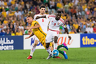 March 28 2017: Socceroos James TROISI (14) gets tripped by United Arab Emirates Ahmed BARMAN (9) at the 2018 FIFA World Cup Qualification match, between The Socceroos and UAE played at Allianz Stadium in Sydney.
