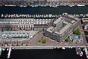 Nederland, Amsterdam, Oostelijk Havengebied,  25-05-2010. Borneo-eiland met gebouw Pacman (Koen van Felsen)en voormalige havengebouw De Oceaan..Former Eastern Docklands.luchtfoto (toeslag), aerial photo (additional fee required).foto/photo Siebe Swart