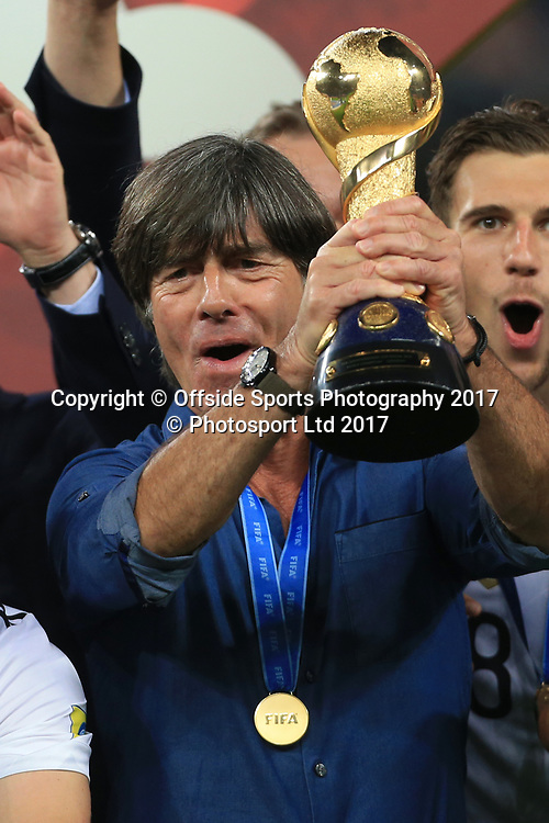 2nd July 2017 - FIFA Confederations Cup Final - Chile v Germany - Germany coach Joachim Low lifts the trophy - Photo: Simon Stacpoole / Offside / www.photosport.nz