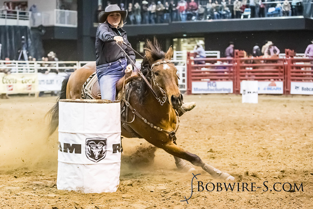 Kesse Deal makes her barrel run at the Bismarck Rodeo on Friday, Feb. 2, 2018. She ran a 19.30.