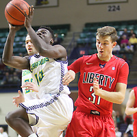 UNCW's Malik Pugh shoots against Liberty's Peter Moller Wednesday December 17, 2014 at Trask Coliseum on the campus of UNCW in Wilmington, N.C. (Jason A. Frizzelle)