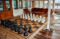 Outdoor chess board on the aft deck of the MV World Odyssey. Prior to departure from Ensenada, Mexico.  Image taken with a Nikon N1 V3 camera and 10-30 mm lens (ISO 200, 10 mm, f/3.5, 1/320 sec).