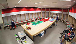 HAIFA, ISRAEL - Saturday, March 28, 2015: Shirts and boots for Wales players laid out in the dressing room ahead of the UEFA Euro 2016 qualifying Group B match against Israel at the Sammy Ofer Stadium. (Pic by David Rawcliffe/Propaganda)