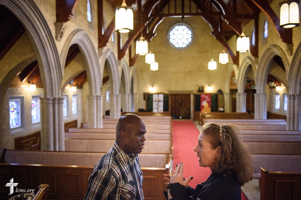 The Rev. Gregory T. Manning, pastor of Gloria Dei Lutheran Church, shows a woman who said she was homeless around the sanctuary of Gloria Dei on Wednesday, March 9, 2016, in New Orleans. The woman attended with a friend for the first time in worship the following Sunday. LCMS Communications/Erik M. Lunsford