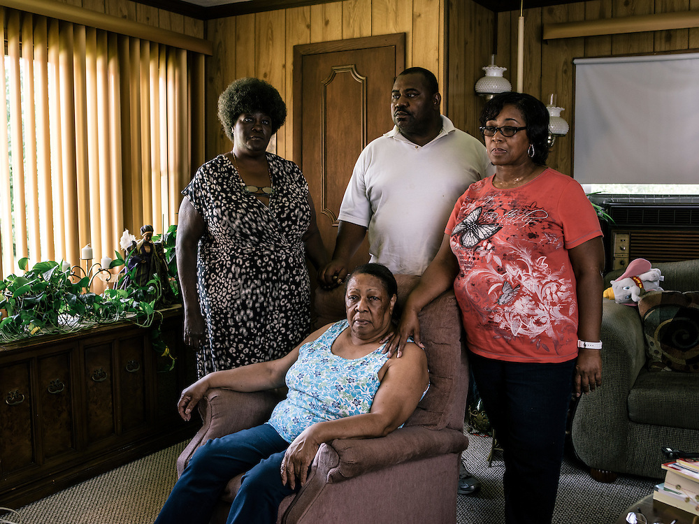 Clara Newton, mother of Odell, and family, from left, Lavenia Newton, sister in law, Tim Newton, brother, and Clara Anderson, sister, Odell has been incarcerated since he was 16. At Clara Newton's home in Baltimore.