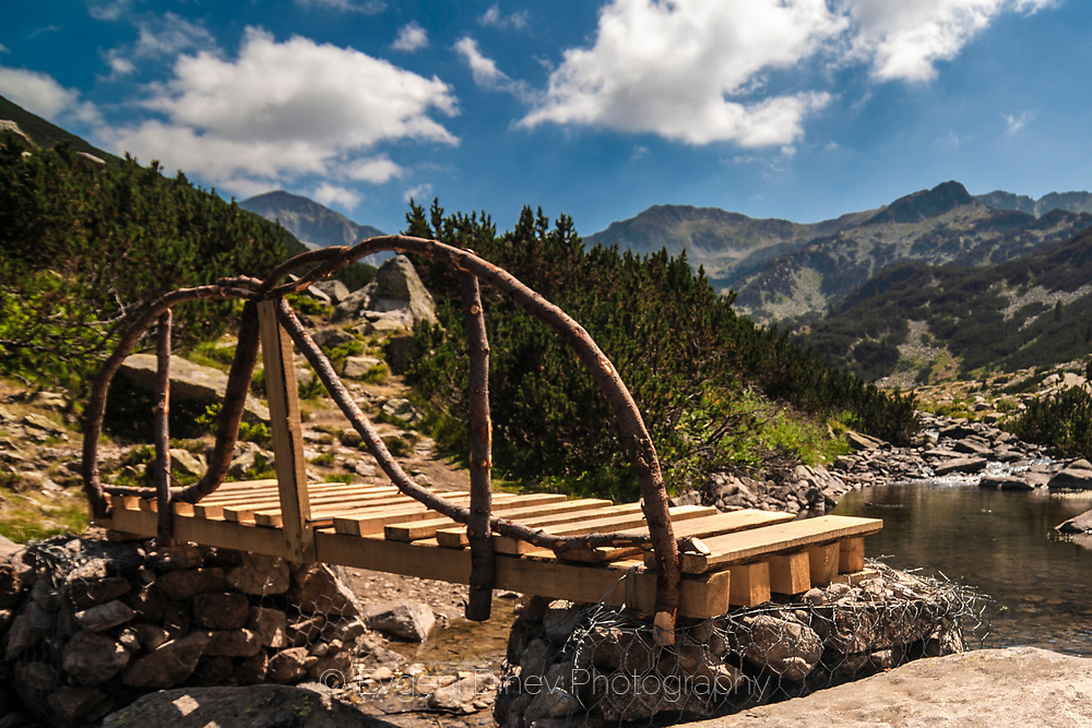 Wooden bridge over a river in the mountain