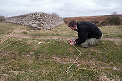 Historian Ashley Cowie with a Pentagram at Dirlot Cemetery. at the 'The Devil's Gold' in Dirlot, Caithness. He is doing a seven part series for The Scottish Sun on Scotland's treasure hunts at the end of April..©Michael Schofield.