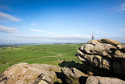© Licensed to London News Pictures. 17/05/2016. North Rigton UK. A man stand on top of Almscliffe Crag in North Rigton this morning to look out over another beautiful morning in Yorkshire. Photo credit: Andrew McCaren/LNP