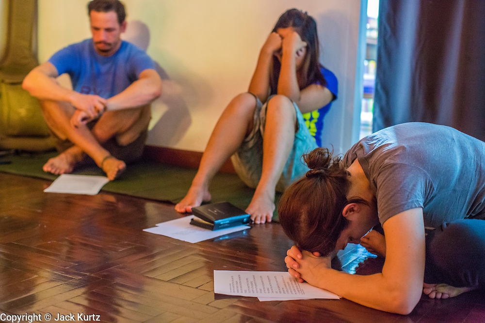 01 APRIL 2013 - BANGKOK, THAILAND:   Prayer before the Hupes go out to work with the street children in the Nana red light district, Left to Right, Tim Hupe, Naamfon Boonlab, their Thai colleague, and Amy Hupe.    PHOTO BY JACK KURTZ