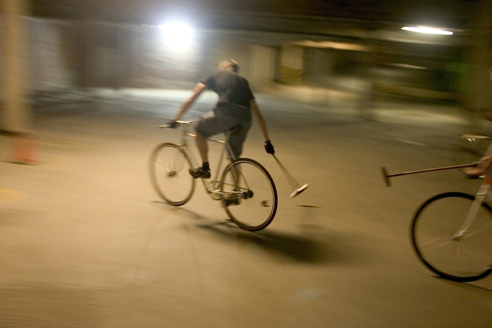A game of bike polo at a parking deck in Durham, NC.
