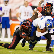 20 October 2018: San Diego State Aztecs defensive lineman Noble Hall (95) and linebacker Kyahva Tezino (44) bring down San Jose State Spartans wide receiver Justin Holmes (9) after a short gain in the third quarter. The Aztecs beat the Spartans 16-13 Saturday night at SDCCU Stadium.