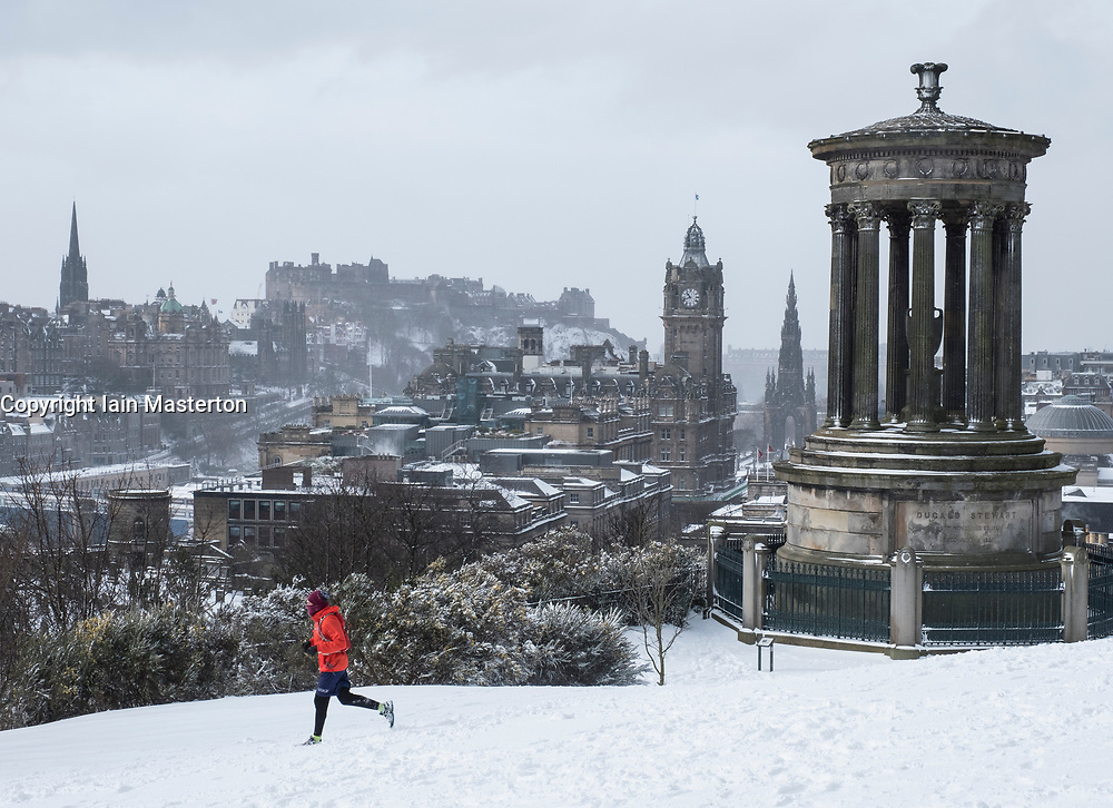 Edinburgh, Scotland, United Kingdom, 1 March, 2018. Heavy snowfalls continue across the city from the storm known as The Beast from the East. Most shops are closed and transport services have been cancelled. Pictured; Jogger runs through snow on Calton Hill