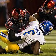 21 October 2016: The San Diego State Aztecs football team takes on the San Jose State Spartans Friday night at Qualcomm Stadium. San Diego State defensive linemen Alex Barrett (58) stops San Jose State running back Deontae Cooper (8) for a short gain in the fourth quarter. The Aztecs beat the Spartans 42-3 to extend there home win streak. www.sdsuaztecphotos.com