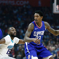 31 December 2017: LA Clippers guard Lou Williams (23) drives past Charlotte Hornets guard Kemba Walker (15) on a screen set by LA Clippers center DeAndre Jordan (6) during the LA Clippers 106-98 victory over the Charlotte Hornets, at the Staples Center, Los Angeles, California, USA.