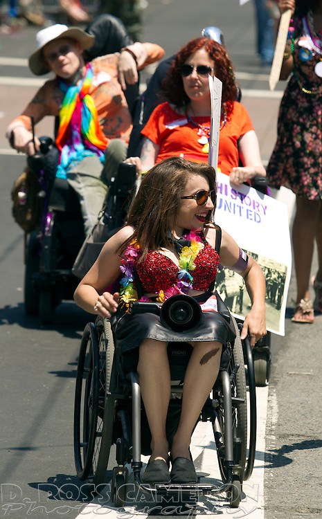 Disabled members of the LGBT community roll their wheelchairs along Market Street at the 43rd annual San Francisco Pride parade, Sunday, June 30, 2013 in San Francisco. (Photo by D. Ross Cameron)