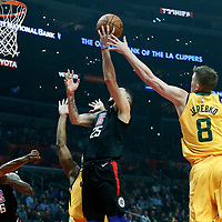 30 November 2017: LA Clippers guard Austin Rivers (25) goes for the layup past Utah Jazz forward Jonas Jerebko (8) during the Utah Jazz 126-107 victory over the LA Clippers, at the Staples Center, Los Angeles, California, USA.