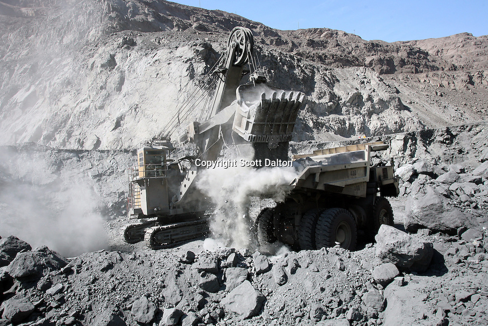 Trucks are loaded with rock at the open pit iron mine of Shougang, a Chinese mining company, just outside of Marcona, in southern Peru, on October 25, 2007. (Photo/Scott Dalton)