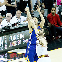 09 June 2017: Golden State Warriors guard Klay Thompson (11) takes a jump shot over Cleveland Cavaliers forward Kevin Love (0) during the Cleveland Cavaliers 137-11 victory over the Golden State Warriors, in game 4 of the 2017 NBA Finals, at  the Quicken Loans Arena, Cleveland, Ohio, USA.