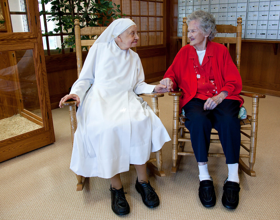 Sister Mary Helen of the  Little Sisters of the Poor rocked last week with resident Ethel McCready at the residence for low-income elderly in North St. Louis. The home's rocking chairs will serve as a prop in a fund-raising event, which includes a competitive run and noncompetitive run and walk Aug. 21 at Carondelet Park in South St. Louis.