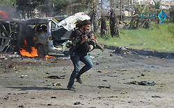 April 15, 2017 - Aleppo, Syria - Syrian photographer ABD ALKADER HABAK put the camera aside to rescue children from a terrorist suicide attack against refugees. (Credit Image: © Muhammad Alrageb/ROPI via ZUMA Press)