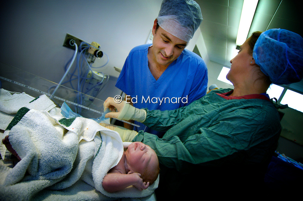 Father sees his baby boy immediately after being delivered by caesarean section, Kettering Hospital, Northamptonshire, UK.