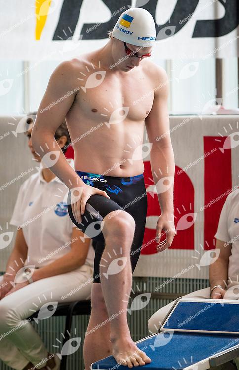 Andriy Govorov Ucraino, nativo di Sebastopoli, Mostra una bandiera del suo paese con la scritta (pace&quot; mentre sale sul blocco di partenza nella prima serie dei 50 Farfalle nella seconda giornata del IV trofeo citta di Milano<br /> IV Trofeo Citta di Milano Swimming Nuoto<br /> Day02 - 8 March 2014<br /> D. Samuele Swimming Pool<br /> Milano Italy<br /> Photo G.Scala/Deepbluemedia/Inside